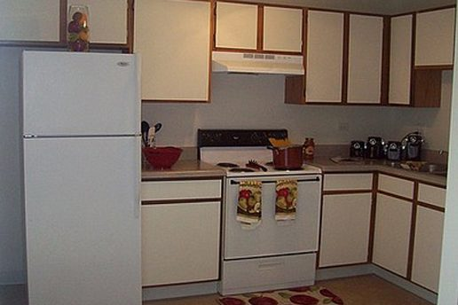 Kitchen, white cabinets with brown trim, white applicances